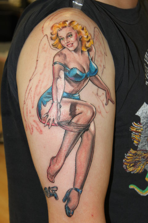 Angel Pin Up Removing Her Socks Tattoo On Arm