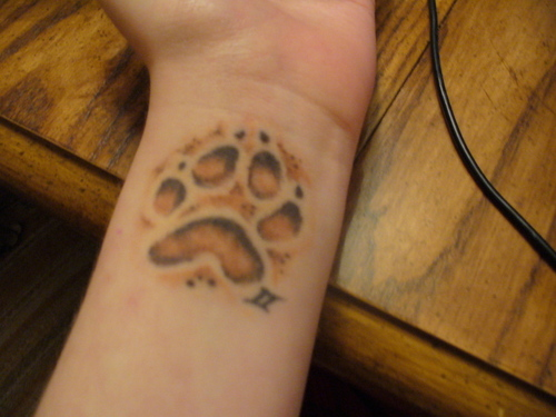 Animal Paw Print And Zodiac Symbol Tattoos On Wrist