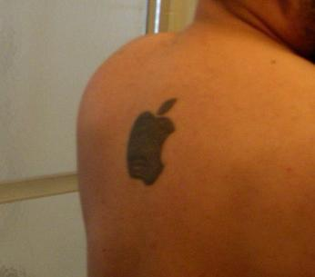 Apple Logo Tattoo On The Back
