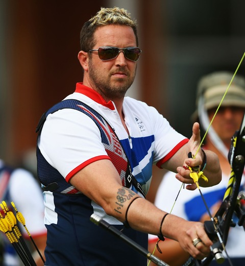 Archer With Olympic Ring Tattoo On Arm