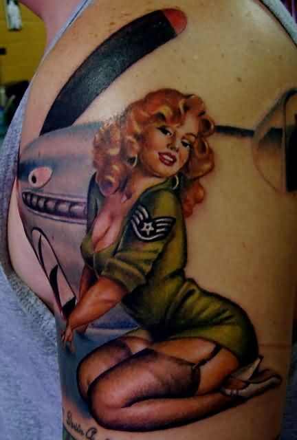 Army Pin Up Girl And Plane Tattoos On Arm