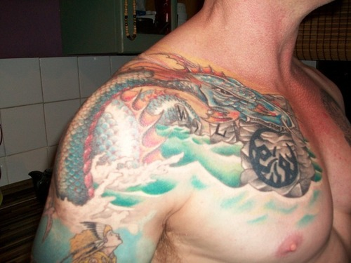 Asian Dragon In Water Tattoo On Chest