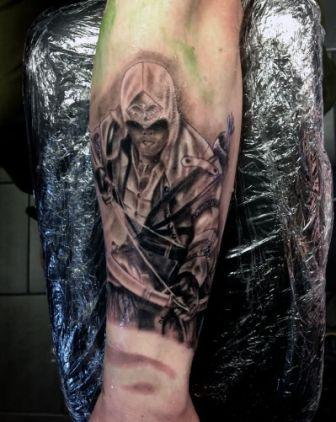 Assassins Creed Archer Tattoo On Lower Arm