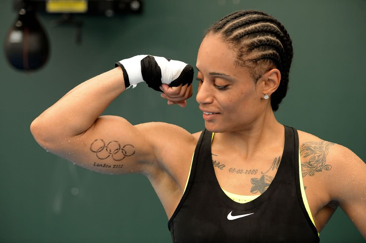 Athlete Showing London Olympic Tattoo On Muscles