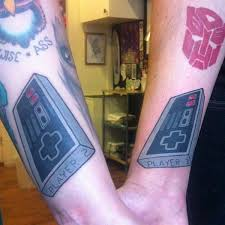 Awesome Game Controller Tattoos On Arm