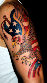 Bald Eagle With American Flag And Puerton Rican Flag Tattoos On Arm