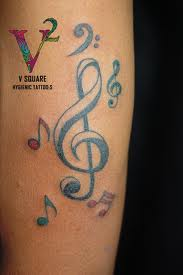 Beautiful Colored Music Symbol Tattoos