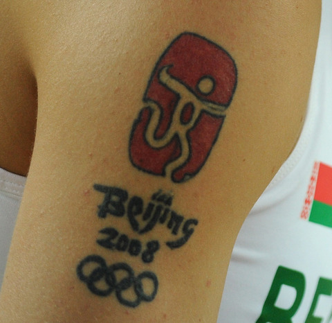 Beijing 2008 Olympic Rings Tattoo On Biceps