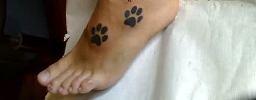 Best Black Ink Paw Print Tattoos On Foot