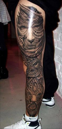 Biomechanical Face And Eye Tattoos On Whole Leg