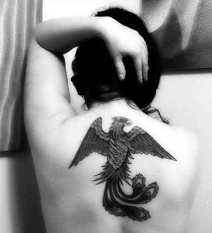 Black And White Phoenix Tattoo On Upperback