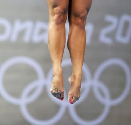Black Olympic Rings Tattoos On Right Foot Of Diver