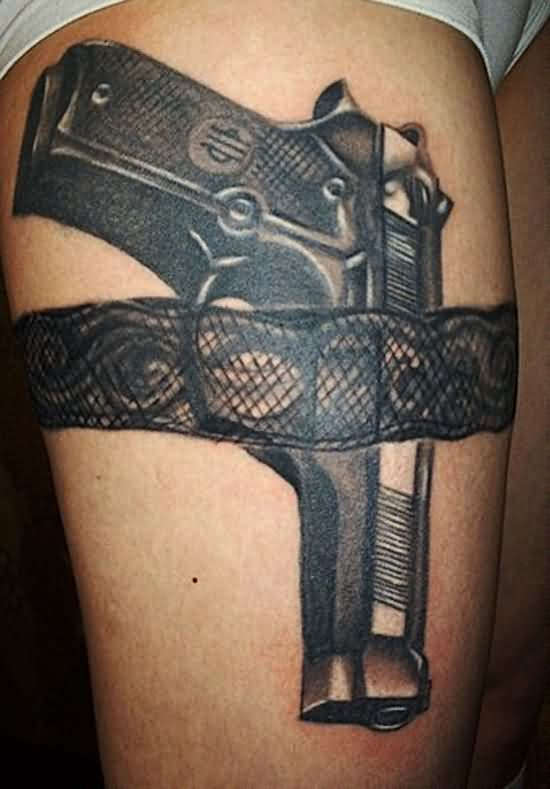 Black Pistol In Lace Belt Tattoo