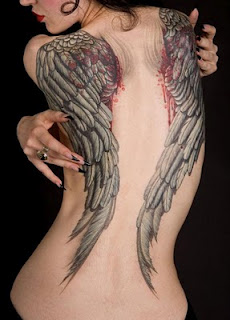 Bleeding Angel Wing Tattoos On The Back