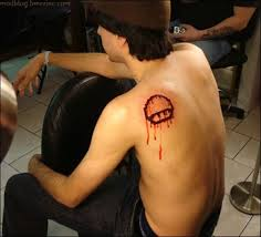 Bleeding Mushroom - Video Game Tattoo On Back Shoulder