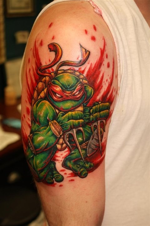 Blood And Ninja Turtle Tattoos On Arm