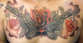 Bloody Red Rose And Pistol Tattoos On Full Chest