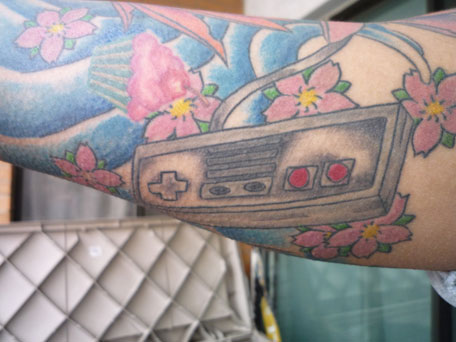 Blossoms And Game Controller Tattoos