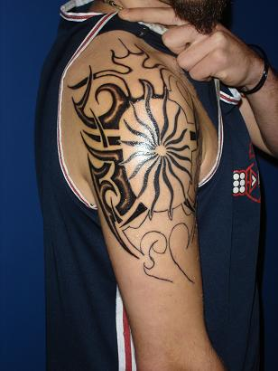 Brad Tribal Sun Tattoo On Shoulder