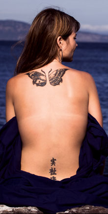 Butterfly And Asian Symbol Tattoos On Back