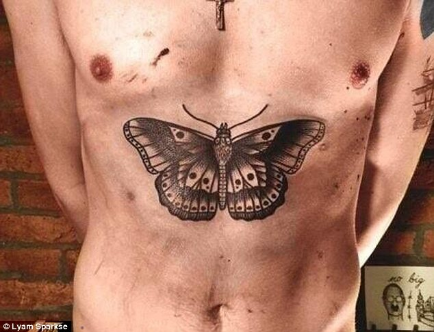 Butterfly Tattoo Below Chest