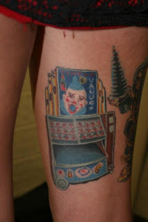 Circus Of Value Tattoo On Thigh