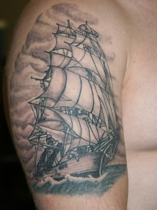 Clouds And Pirate Ship Tattoos On Shoulder