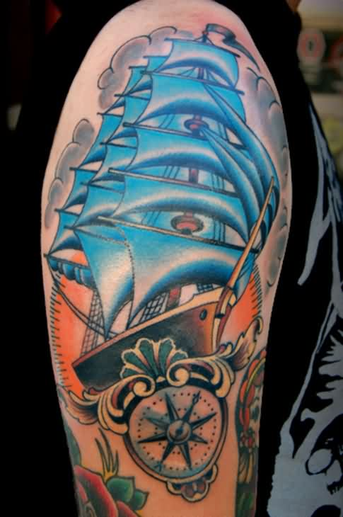 Clouds Pirate Ship And Nautical Compass Tattoos On Arm
