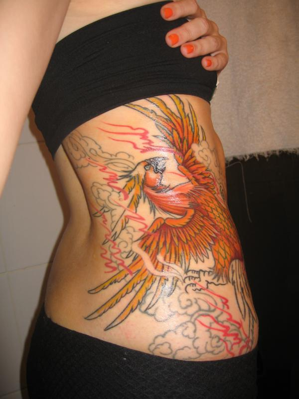 Clouds Red Flames And Phoenix Tattoos On Ribs