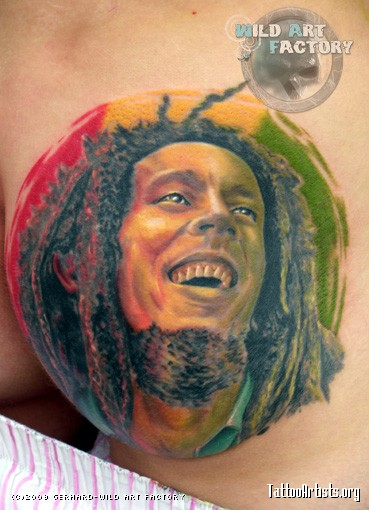 Colorful Bob Marley Portrait Tattoo On Chest