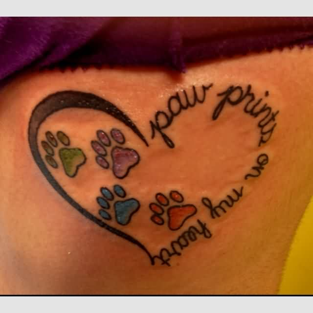 Colorful Paw Prints In Heart Tattoo