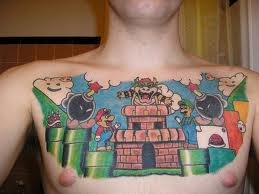 Colorful Video Game Chest Piece Tattoos