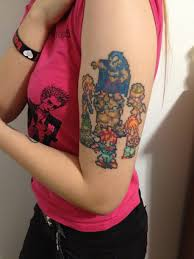 Colorful Video Game Tattoos On Biceps