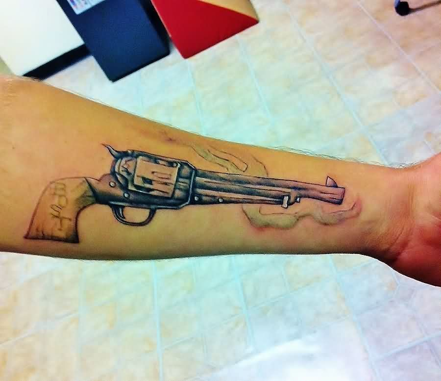 Colt Pistol And Flame Tattoos On Forearm