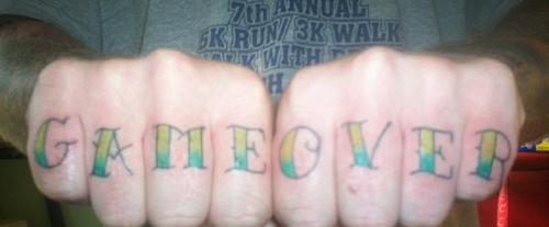 Cool Game Over Knuckle Tattoos