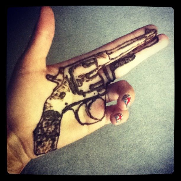 Cool Henna Pistol Tattoo