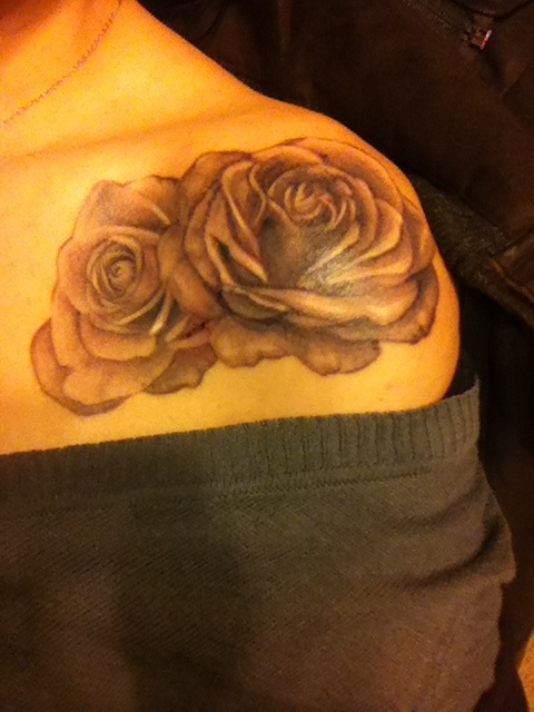 Couple Of Grey Rose Tattoos On Front