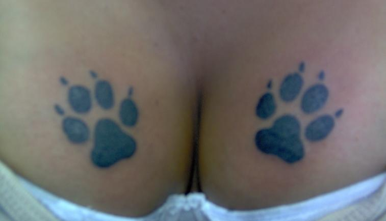 Couple Of Paw Print Tattoos On Breast