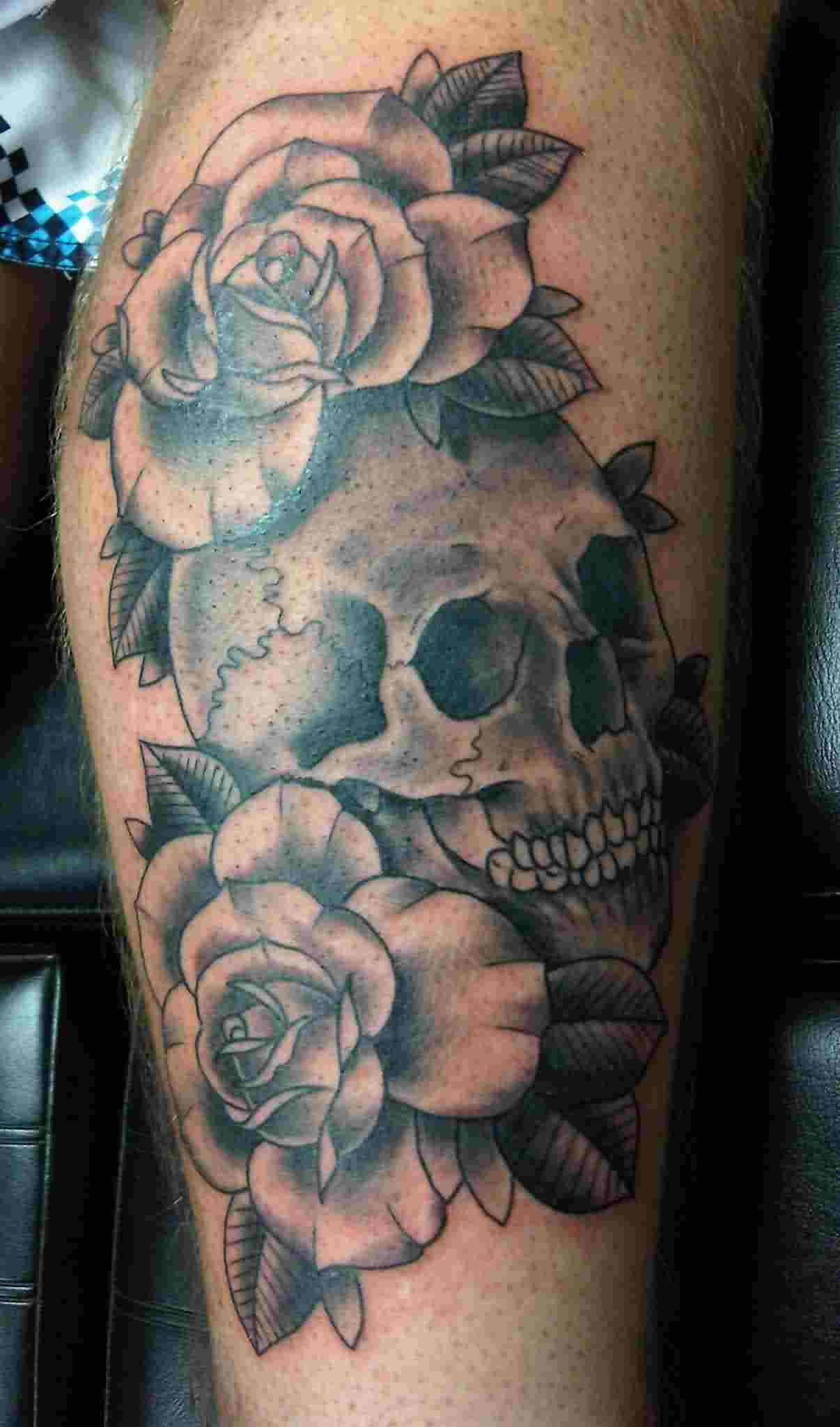 Couple Of Rose And Cracked Skull Tattoos