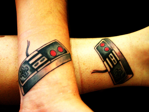 Couple With Nintendo Controllers Tattoos