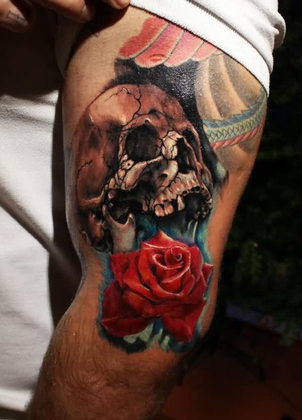 Cracked Skull And Red Rose Tattoos On Thigh