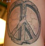 Cracked Stone Peace Sign Tattoo