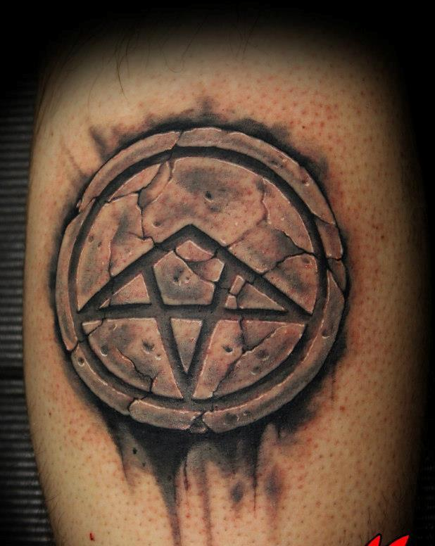 Cracked Stone Symbol Tattoo