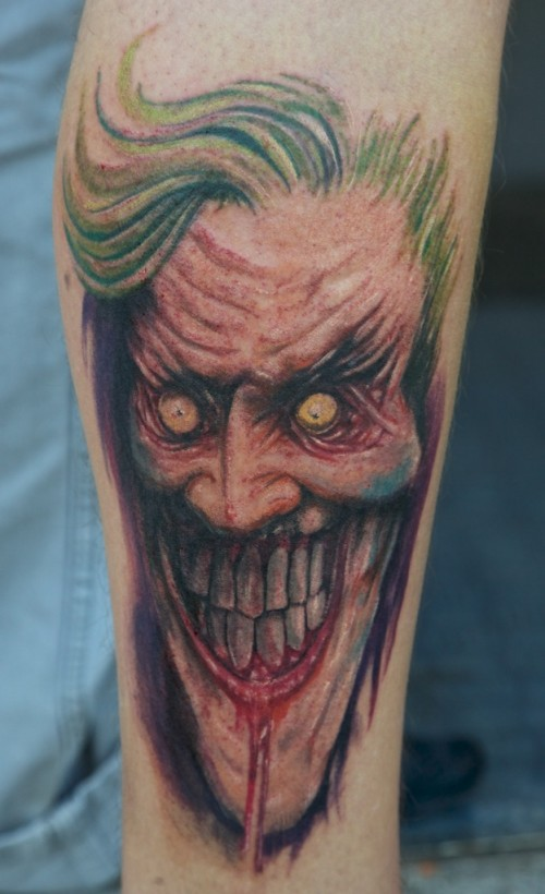 Creepy Joker Face Tattoo On Arm