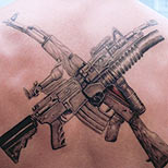 Crossed Military Gun Tattoos On The Back