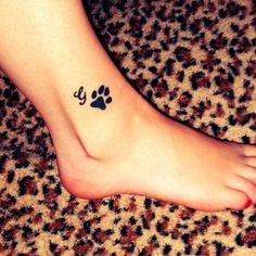 Cursive Alphabet And Paw Print Tattoos On Ankle