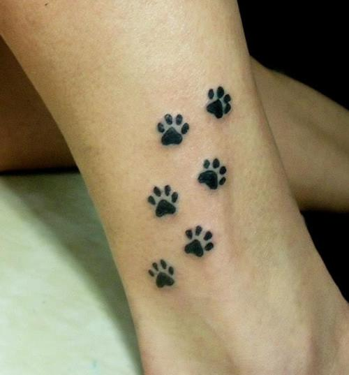 Cute Black Paw Print Tattoos Above Ankle