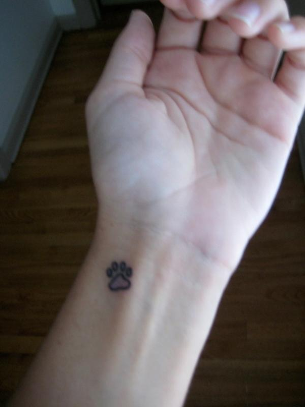 Cute Paw Tattoo On Inner Wrist