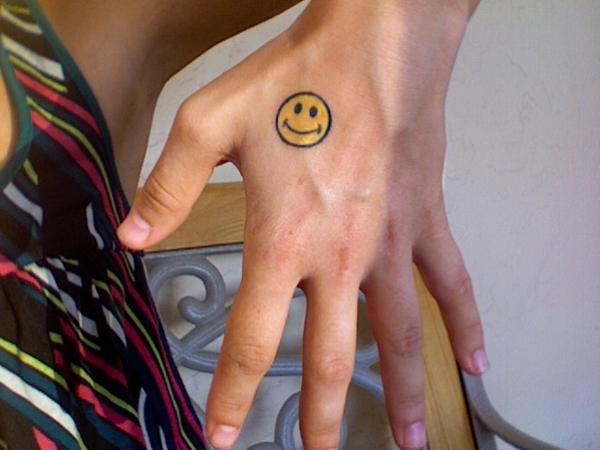 Cute Smiley Tattoo On Hand