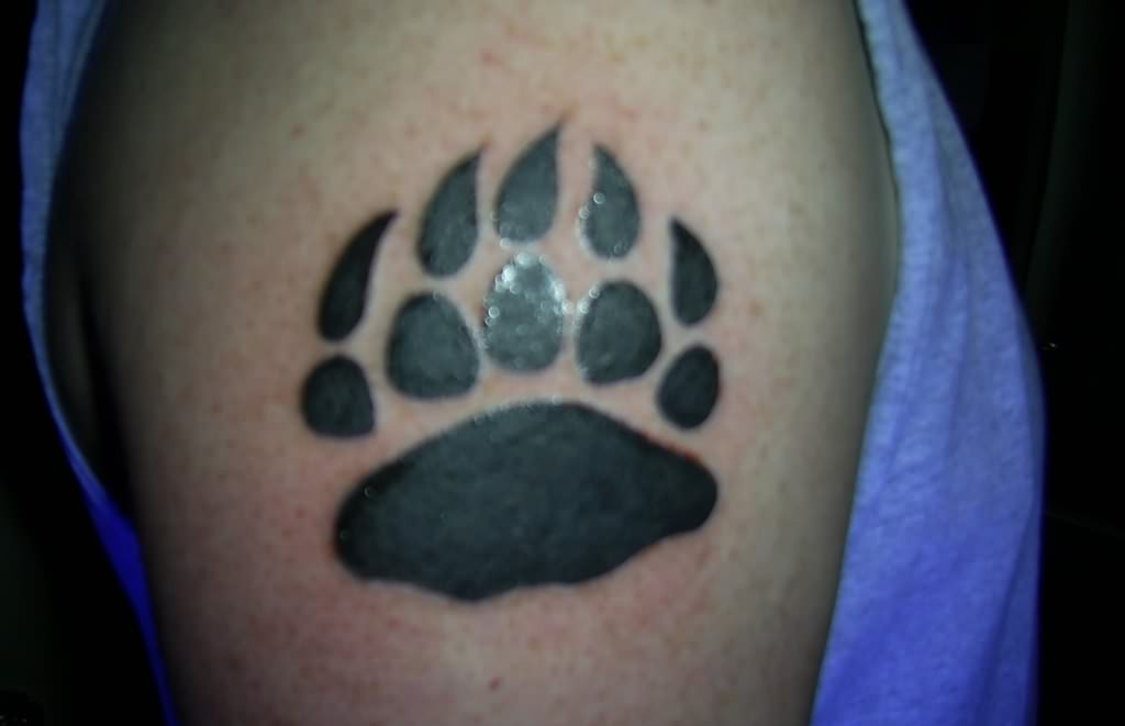 Dark Black Bear Paw Print Tattoo On Biceps